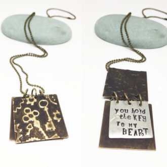 hand-stamped-key-to-my-heart-book-necklace-side-by-side