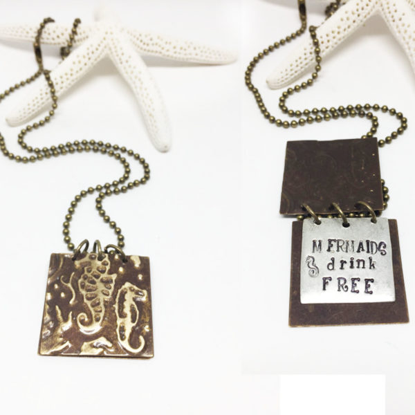 hand-stamped-mermaids-drink-free-book-necklace-side-by-side